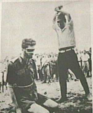 Jap officer about to behead Australian flyer